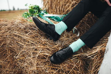 Funny blue socks of the groom in the wedding day