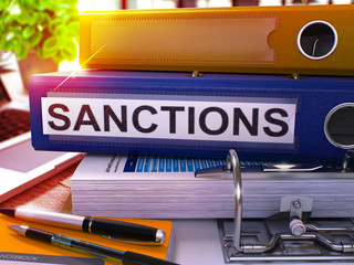 Sanctions - Blue Office Folder on Background of Working Table with Stationery and Laptop. Sanctions Business Concept on Blurred Background. Sanctions Toned Image. 3D. Wall mural
