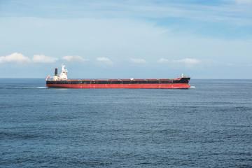 Dry cargo ship in the calm ocean.