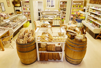 Interior of a local delicatessen and eatery with breads displaye