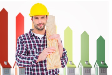 Composite image of handyman holding wood planks