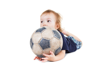 Baby boy playing with a soccer ball. Isolated on white