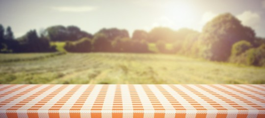 Composite image of orange and white tablecloth