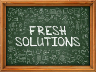 Fresh Solutions - Hand Drawn on Chalkboard. Fresh Solutions with Doodle Icons Around.