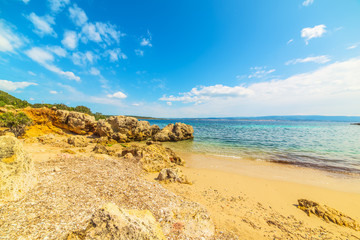 yellow rocks and golden sand in Alghero