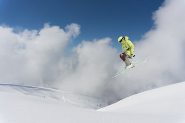Ski rider jumping on mountains. Extreme ski freeride.