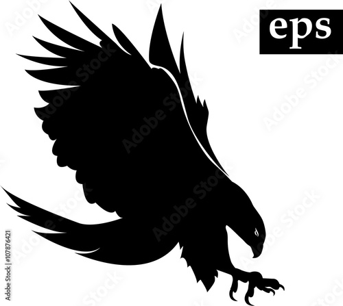 black silhouette of flying eagle with spread wings