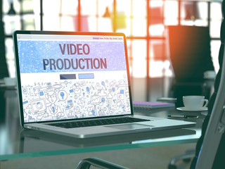 Video Production Concept. Closeup Landing Page on Laptop Screen in Doodle Design Style. On Background of Comfortable Working Place in Modern Office. Blurred, Toned Image. 3D Render.