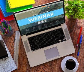 Webinar Concept. Modern Laptop and Different Office Supply on Wooden Desktop background. 3D Render.