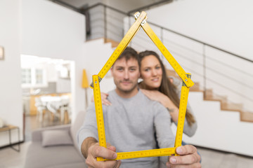 young couple happpy in a new house