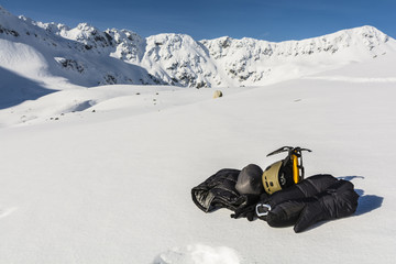 Helmet, ice axe and clothing down.