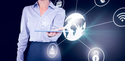 Composite image of businesswoman holding digital tablet