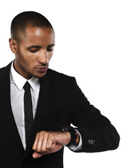 young businessman checking the time.