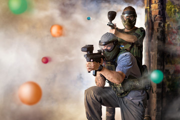 Play paintball game