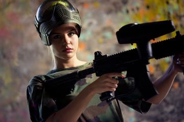 Woman paintball gamer