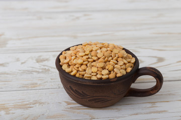 Yellow peas on wooden background