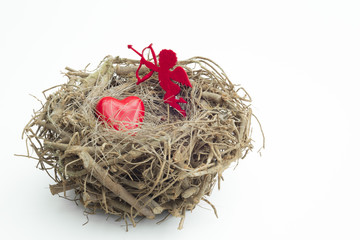 Heart and cupid figure placed into a wooden bird nest