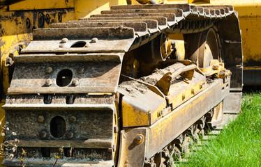 Detail of muddy caterpillar tracks on bulldozer.