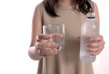 Cute Caucasian woman holding a glass of water on white backgroun