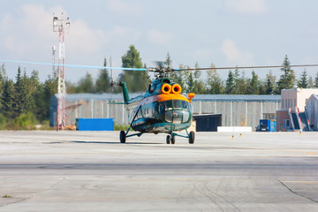 Helicopter taxiing on the airport apron
