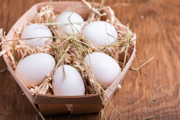 chicken eggs in basket