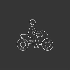 Man riding motorcycle. Drawn in chalk icon.