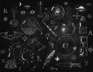 Alchemy symbols collection on chalkboard. Philosophy, spirituality, occultism, chemistry, science, alchemy and magic symbols.
