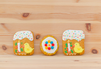 spring easter gingerbread with chick and candle on the wood