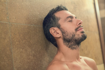 Black beard undressed man relaxing at spa