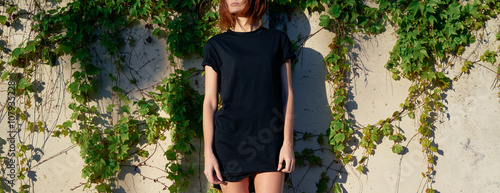 596afa4fdb272 beautiful young woman wearing a black t-shirt posing on a blank background  of a