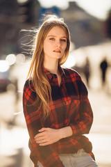 Girl sitting on the street