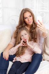 Pretty woman and little girl having fun