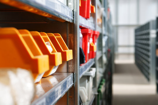 Storage bins and racks in an industrial warehouse shot with shallow focus