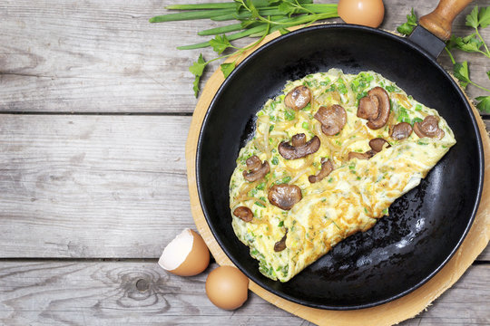 French omelet with herbs, stuffed with mushrooms and onions