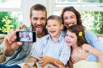 Smiling family taking selfie