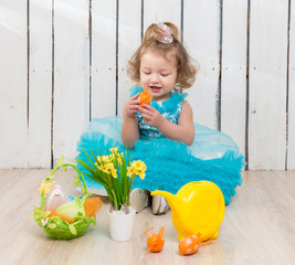 beautiful little girl on the floor with easter decorations