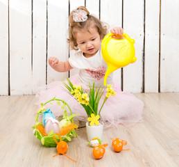 funny little girl watering flowers