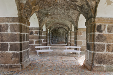 Two white benches in corridor of the castle Bečov in Czech Republic