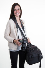 Professional photographer with camera and bag on white background