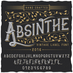 Absinthe label font and sample label design with decoration and ribbon. Vintage font. Whiskey font. Fine label font. Handcrafted font. Decoration font. Font style. Retro font. Old font
