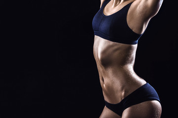 Fitness girl on black background