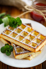 baked cheese waffles with powdered sugar