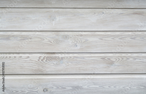 White wash painted texture wooden background of shelves planks with growth rings and wood grain vains