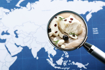 Popular food concept. Looking for feta cheese on world map