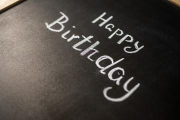 happy birthday title drawn with chalk on the blackboard