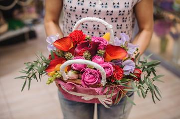 beautiful bouquet of bright flower basket in hands
