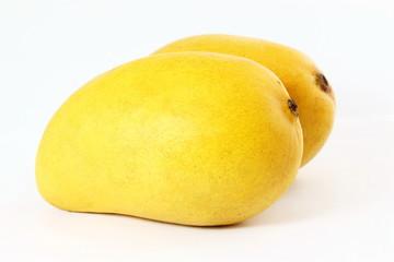 yellow mango fruit closeup isolated on white background