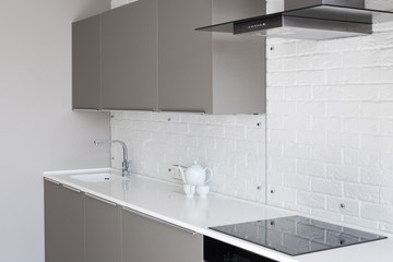 White new modern kitchen with counter top and exhaust hood