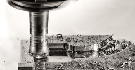 Milling cutter work with splinters flying off, monochrome versio