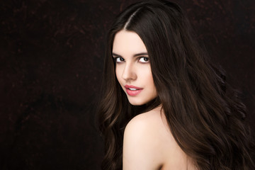 Beautiful young woman with healthy long hair.